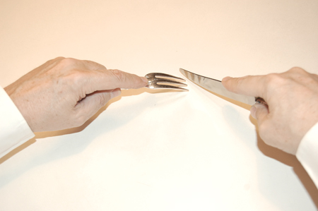 holding a fork when also using a knife