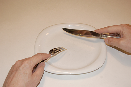 cutting and eating with a fork and knife