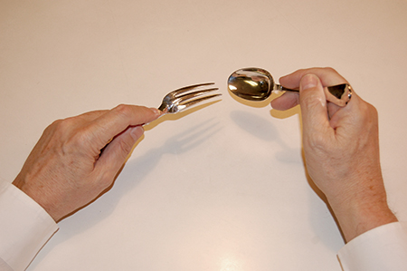 eating with a dessert fork and spoon